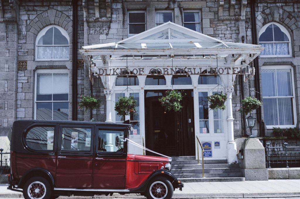 Duke Cornwall Hotel Mini Wedding Collection time-lapse video. Shot of the hotel entrance with vintage car parked outside.