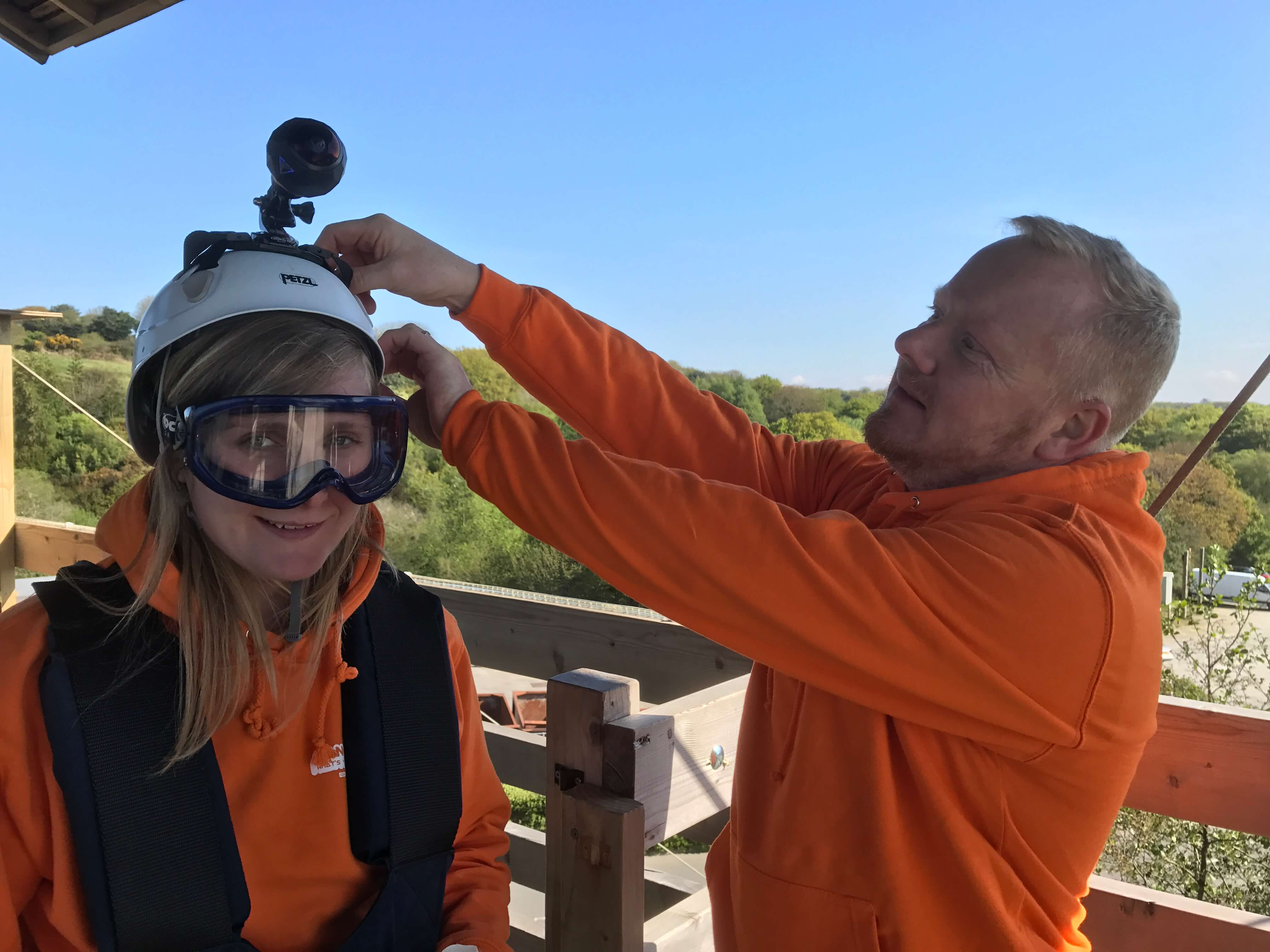 Promotional video production Hangloose Cornwall creating 360 VR tour. Gareth attaching a GoPro on to a participant's helmet.